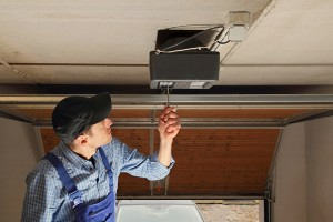 Garage-door-contractor-working-on-repairing-a-garage-door
